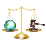 Golden scales with earth globe and gavel. Isolated Stock Image