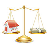 Golden scales with house and money stack Stock Photo