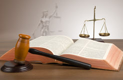 Golden scales of justice, gavel and books. Mallet, legal code and scales of justice. Law concept, studio shots Royalty Free Stock Photo