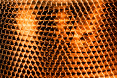 Golden scaly metal blurred background.  Royalty Free Stock Photography