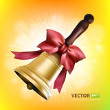 Golden school metal bell with red bow  and wooden handle  on colorful background Royalty Free Stock Images