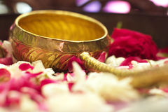 Golden scoop in water with Flower petals. Flower petals in water with golden scoop use for java ceremony, like wedding, purification artifacts, etc Royalty Free Stock Photography