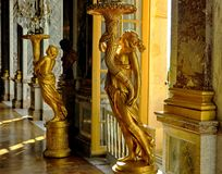 Golden sculpted candlesticks in Versailles royalty free stock image