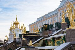 Golden sculptural decoration on the Grand cascade, Fountain in Peterhof, Winter. The Grand cascade is the most grandiose fountain construction of the Peterhof royalty free stock images