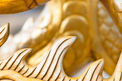 Golden sculpture close-up showing dragon spine. Royalty Free Stock Images