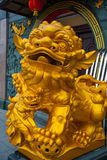 The Golden sculpture at the entrance. Tua Pek Kong Chinese Temple. Bintulu city, Borneo, Sarawak, Malaysia. The Golden sculpture at the entrance Tua Pek Kong Stock Photo