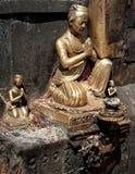 Golden sculpture of praying man at  Swayambhunath Stupa. Monkey Temple Nepal, Kathmandu Stock Photos