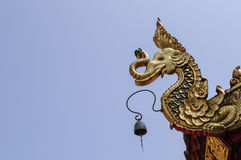 Golden sculpture, thailand. Golden sculpture on the roof of temple Stock Images