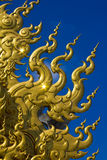 Golden sculpture at Wat Rong Khun stock photo
