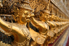 Golden sculptures in a temple Stock Photography