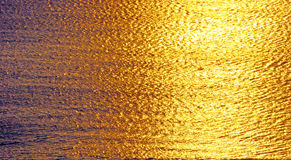 Golden sea. Golden reflections of the sun on the sea royalty free stock images
