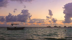 Golden sea sunrise and boats in caribbean sea. Punta Cana, Dominican Republic.  stock video