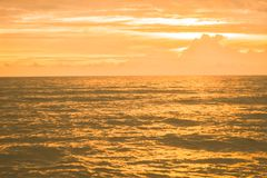 Golden sea  in sunset background. Golden sea  in sunset peacful ,calm nature   background Stock Photo