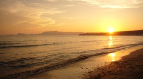 Golden Sea. Golden sunset on Les Lecques beach, France Royalty Free Stock Images