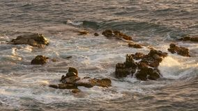 Golden Sea Water on the Rocks stock video