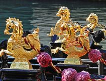 Golden seahorses on a gondola. royalty free stock image