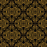 Golden seamless damask Pattern on black. Royalty Free Stock Images