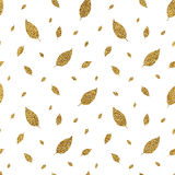 Golden seamless pattern autumn leaves. Hand painted gold glitter autumn background of falling leaf, vector design for fabric, textile, wrapping paper, card Royalty Free Stock Images