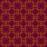Golden seamless pattern. On dark red background Royalty Free Stock Image