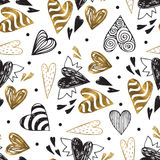Golden seamless pattern with the image of tribal hearts Stock Images