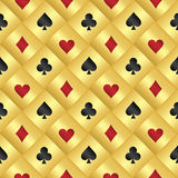 Golden seamless pattern with poker card symbols Royalty Free Stock Photos