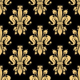 Golden seamless pattern of royal fleur-de-lis Royalty Free Stock Images