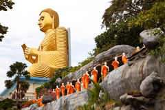 Golden seated buddha in dambulla, sri lanka Royalty Free Stock Image