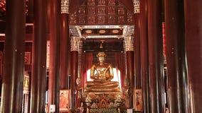 Golden seated Buddha Statue. Chiangmai, Thailand - Oct 6, 2015 : Golden seated Buddha Statue in the temple of Wat Lok Molee Chiangmai stock footage