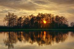 Golden Sensation. Of sunset and beautiful  reflection on the pond Stock Photo