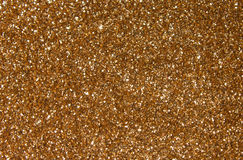 Golden sequins - sparkling sequined textile. Sparkling, metallic, golden, sequined textile for disco, party or fashion designs royalty free stock images