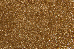 Golden sequins - sparkling sequined textile. Sparkling, metallic, golden, sequined textile for disco, party or fashion designs toned stock image