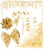 Golden serpentine streamer, confetti, ribbon bow Stock Photo