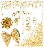 Golden serpentine streamer, confetti, ribbon bow Stock Photo