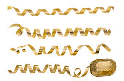 Golden serpentine streamers. Holidays party decoration Stock Photo