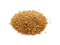 Golden sesame seeds Stock Photos