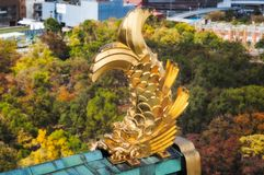 Golden Shachi - Roof ornaments at Osaka Castle in Japan. A mythical creature with the head of a tiger and body of a carp, protectors of the castle. Osaka stock image