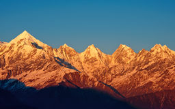 Golden shade of snow clad mountain peak. Panchachuli a cluster of five snow clad peaks is  located on Kumaon region of Uttrakhand, India. These five snow clad Royalty Free Stock Photos