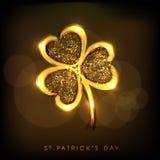 Golden shamrock leaf for Happy St. Patricks Day. Stock Photo