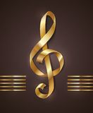 Golden shape of treble clef. Gold ribbon in the shape of treble clef Royalty Free Stock Image
