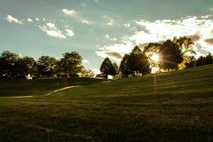 Golden Sheboygan Sunset. Lovely sunset casting its soft golden light over the hills at Kiwanis Park in Sheboygan, Wisconsin royalty free stock images