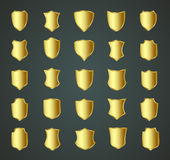 Golden shield design set with various shapes Royalty Free Stock Images