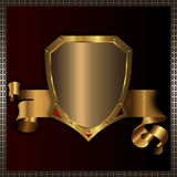 Golden shield and golden ribbon. Royalty Free Stock Photos