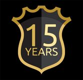 Golden shield 15 years Royalty Free Stock Photo