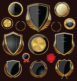 Golden Shields, labels and laurels, black edition Stock Photography