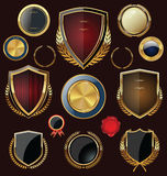 Golden Shields, labels and laurels, black edition Royalty Free Stock Images