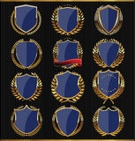 Golden Shields, labels and laurels, dark blue edition Stock Images