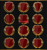 Golden Shields, labels and laurels, dark red edition Royalty Free Stock Image