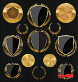 Golden Shields, labels and laurels, gold and black collection. Illustration Royalty Free Stock Photos