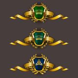 Golden shields with laurel wreath Royalty Free Stock Image