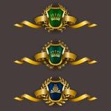 Golden shields with laurel wreath. Set of luxury golden vector shields with laurel wreaths, crowns, ribbons. Royal heraldic emblem, icons, label, badge, blazon Royalty Free Stock Image